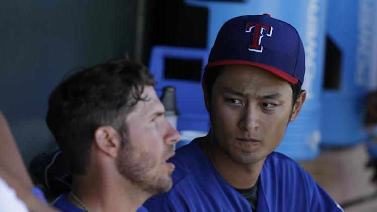 Texas Rangers starting pitcher Yu Darvish in action during a spring exhibition baseball game against the Cincinnati Reds Monday, March 10, 2014, in Suprise, Ariz. (AP Photo/Darron Cummings)