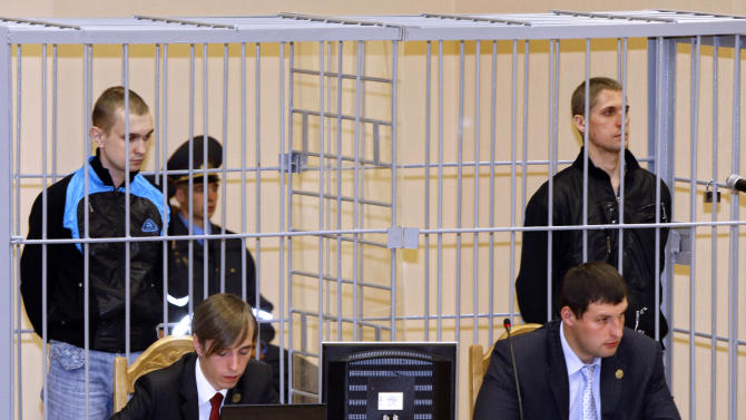 FILE- In this Thursday, Sept. 15, 2011 file photo, Belarusians, Dmitry Konovalov, left, and Vladislav Kovalev stand in a defendant's cage during a court session in Minsk, Belarus. The mother of Vladislav Kovalev, Lubov Kovaleva confirmed Saturday March 17, 2012, that her son has been executed, after she received official notification about the execution.  Kovalev and Konovalov, both 26-years old, were convicted in November 2011 of planting a bomb in April 2011, that had killed 15 people and wounded some hundreds more at the busiest subway station in Belarus' capital, Minsk. (AP Photo/Sergei Grits, File)