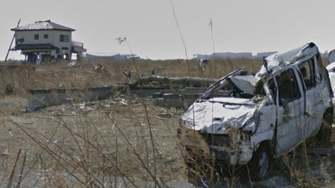 In this screenshot made from the Google Maps website provided Wednesday, March 27, 2013, by Google, showing tsunami-hit cars and houses are seen in March, 2013, in Namie, Japan, a nuclear no-go zone where former residents have been unable to live since they fled from radioactive contamination from the Fukushima Dai-ichi nuclear power plant two years ago. Google Street View is giving the world a rare glimpse into Japan's eerie ghost town, following the March 2011 earthquake and tsunami which sparked a nuclear disaster that has left the area uninhabitable.  (AP Photo/Google) EDITORIAL USE ONLY