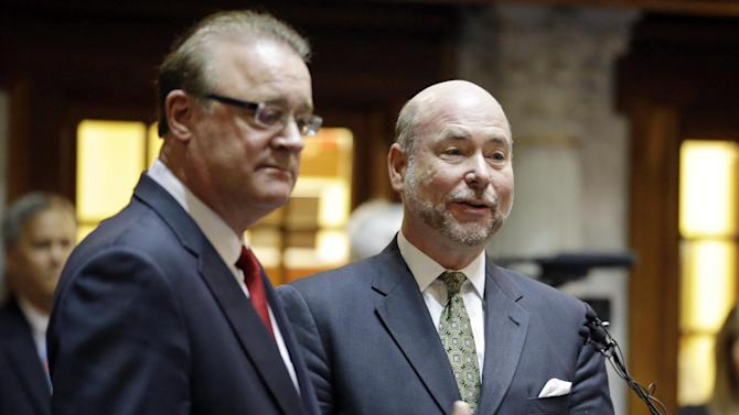 Indiana Senate President Pro Tem David Long, left, (R-Fort Wayne) and House Speaker Brian C. Bosma (R-Indianapolis) discuss their plans for clarifying the Indiana Religious Freedom Restoration Act during a press conference at the Statehouse in Indianapolis, Monday, March 30, 2015.  Republican legislative leaders in Indiana state say they are working on adding language to a new state law to make it clear that it doesn't allow discrimination against gays and lesbians.  (AP Photo/Michael Conroy)
