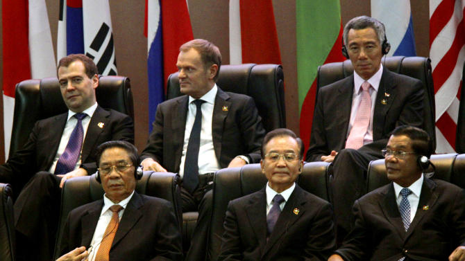 Russia's Prime Minister Dmitry Medvedev, top left, Poland's Prime Minister Donald Tusk, top center, Singapore's Prime Minister Lee Hsien Loong, top right, Laos' President Choummaly Sayasone, bottom left, China's Premier Wen Jiabao, bottom center, and Cambodia's Prime Minister Hun Sen take part in the opening ceremony for the ASEM Summit in Vientiane, Laos, Monday, Nov. 5, 2012.  (AP Photo/Sakchai Lalit)