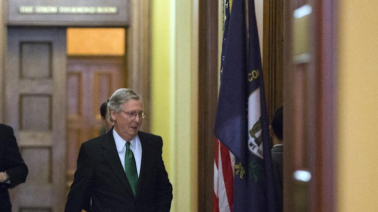Senate Minority Leader Mitch McConnell, from Kentucky, departs the Strom Thurmond room after a Senate Republican caucus meeting about the fiscal cliff, on Capitol Hill, Monday, Dec. 31, 2012 in Washington. (AP Photo/Alex Brandon)
