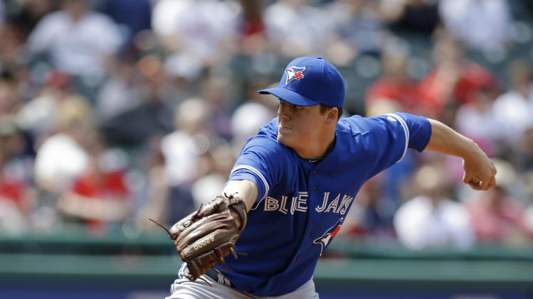 Toronto Blue Jays relief pitcher Aaron Loup  delivers in the sixth inning of a baseball game against the Cleveland Indians, Sunday, April 20, 2014, in Cleveland. (AP Photo/Tony Dejak)