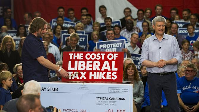 Canada's Prime Minister and Conservative leader Stephen Harper looks on during a skit during a campaign rally in London