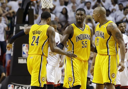 Indiana Pacers forward Paul George (24) is congratulated on his basket by Roy Hibbert (55) and David West (21)  during the second half of Game 1 in their NBA basketball Eastern Conference finals playo