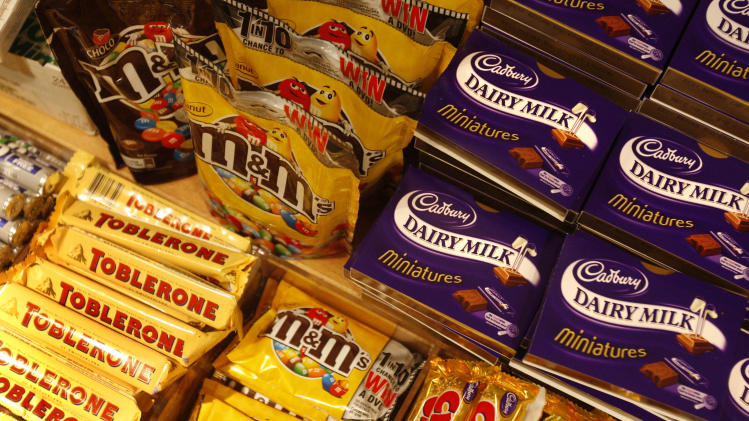 FILE - This is a Tuesday, Jan. 19, 2010 file photo of chocolate bars on a shelf at a store in central London, Tuesday, Jan. 19, 2010. The World Health Organization says your daily sugar intake should be just 5 percent of your total calories half of what the agency previously recommended, according to new draft guidelines published Wednesday March 5, 2014. (AP Photo/Sang Tan. File)