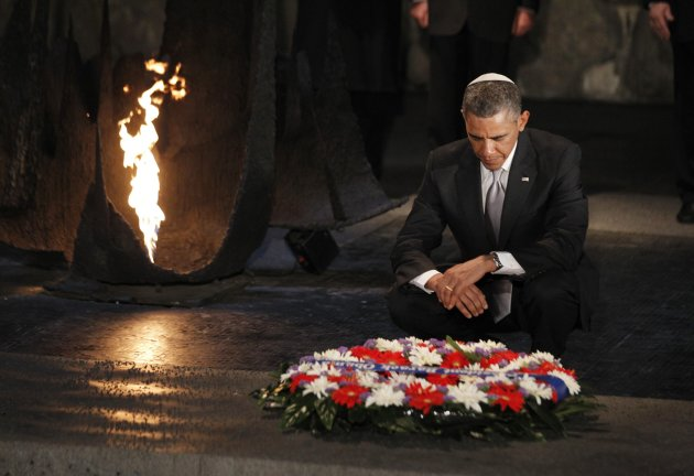 U.S. President Barack Obama pauses for a moment as he lays a wreath at the Hall of Remembrance during his visit to the Yad Vashem Holocaust Memorial in Jerusalem
