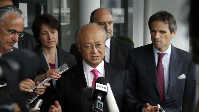 """Director General of the International Atomic Energy Agency, IAEA, Yukiya Amano, center, from Japan speaks to the media after returning from Iran at the Vienna International Airport near Schwechat, Austria, on Tuesday, May 22, 2012. Amano says he has reached a deal with Iran on probing suspected work on nuclear weapons and adds that the agreement will """"be signed quite soon."""" (AP Photo/Ronald Zak)"""