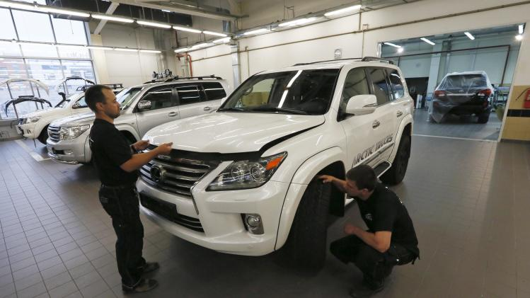 Russian mechanics work on an Arctic Trucks all-terrain vehicle, based on the Lexus LX570 car, at an assembly shop of the Arctic Trucks Russia plant in Krasnoyarsk