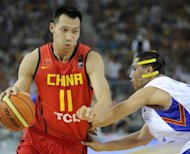 Chinese NBA basketball player Yi Jianlian (L) during a Asian Basketball Championships match in China on September 16, 2011. Yi, the main man in the post-Yao Ming era, will return to play in China, state media reported, as the NBA season is threatened by a protracted lockout of players