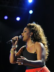 "FILE - In this July 8, 2012 photo, Syleena Johnson performs a tribute to Whitney Houston at the Essence Music Festival in New Orleans. TV reality show, ""R&B Divas,"" which airs Mondays at 10 p.m. EDT has an episode that shows the women's tribute performance from the 2012 Essence Music Festival honoring Whitney Houston, Etta James and others. (Photo by Cheryl Gerber/Invision/AP, File)"