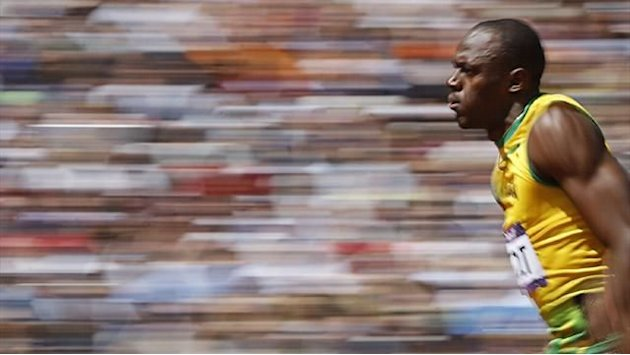 Bolt retains Olympic 100m gold in Olympic record time