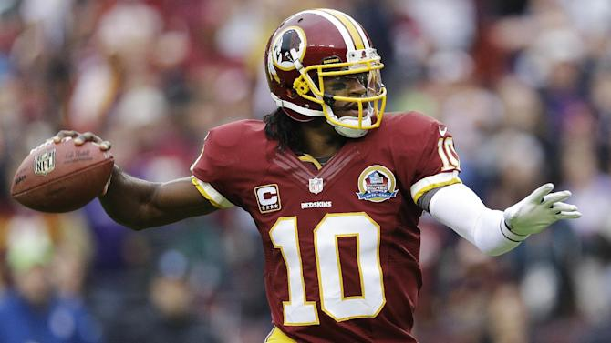 Washington Redskins quarterback Robert Griffin III passes the ball during the first half of an NFL football game against the Baltimore Ravens in Landover, Md., Sunday, Dec. 9, 2012. (AP Photo/Patrick Semansky)