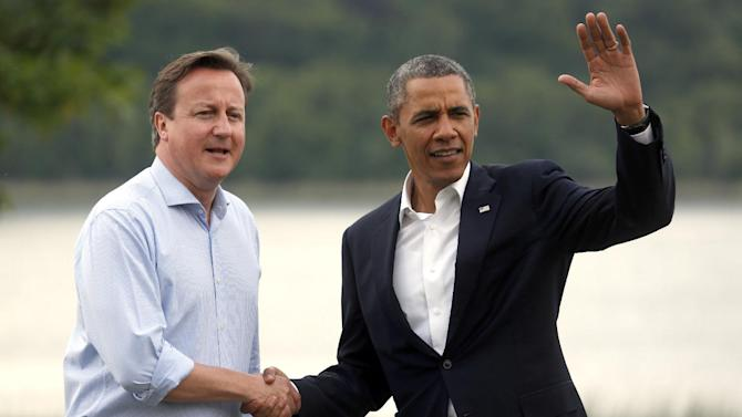 Britain's Prime Minister David Cameron, left, shakes hands with US President Barack Obama during arrivals for the G-8 summit at the Lough Erne Golf Resort in Enniskillen, Northern Ireland on Monday, June 17, 2013. (AP Photo/Lefteris Pitarakis)