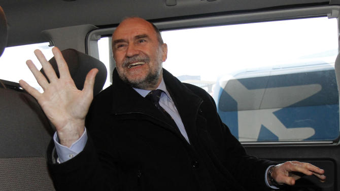 Herman Nackaerts, Deputy Director General and Head of the Department of Safeguards of the International Atomic Energy Agency, IAEA, waves as he arrives from Iran at Vienna's Schwechat airport, Austria, on Friday, Dec. 14, 2012. Nackaerts says his team made headway during talks in Tehran meant to restart an investigation of suspicions the Islamic Republic may have secretly worked on a nuclear arms program. He says that means the U.N. nuclear agency expects to resume its probe early next year. (AP Photo/Ronald Zak)