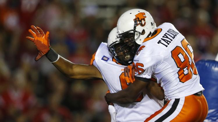 BC Lions' Jackson celebrates his game-winning touchdown with Taylor during their CFL football game against the Calgary Stampeders in Calgary