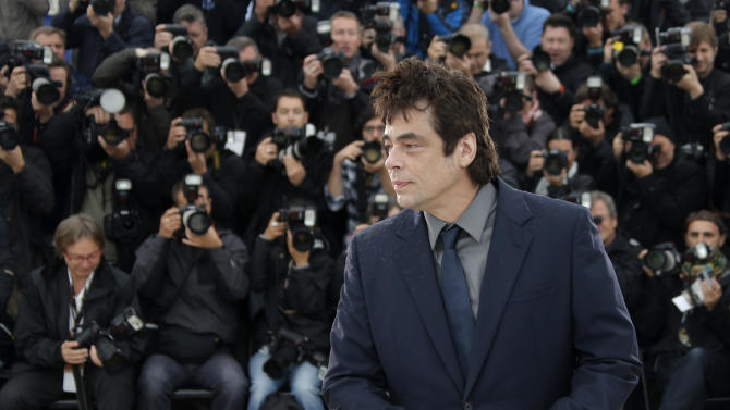Actor Benicio Del Toro poses for photographers during a photo call for the film Jimmy P. Psychotheraphy of a Plains Indian at the 66th international film festival, in Cannes, southern France, Saturday, May 18, 2013. (AP Photo/Francois Mori)