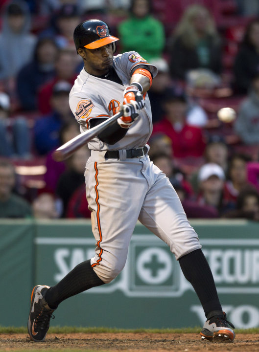 Baltimore Orioles' Adam Jones hits a three-run home run off Boston Red Sox's Darnell McDonald in the 17th inning of a baseball game at Fenway Park, in Boston, Sunday, May 6, 2012. The Orioles defeated