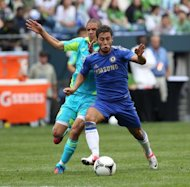 Chelsea&#39;s Eden Hazard (R) dribbles past Seattle Sounders&#39; Osvaldo Alonso during their match in Seattle on July 18. Hazard scored in the 11th minute off a deflection