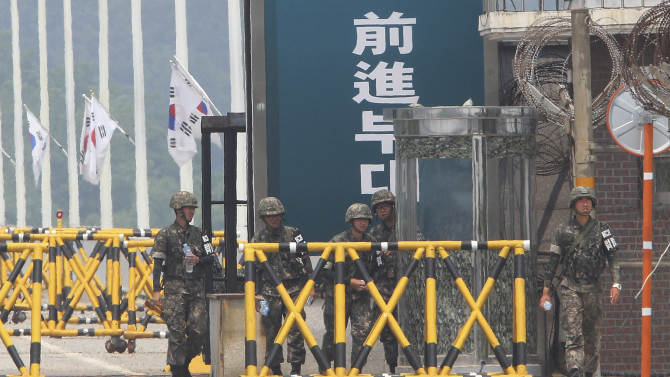 South Korean army soldiers stand guard at Unification bridge, which leads to the demilitarized zone, near the border village of the Panmunjom in Paju, South Korea, Friday, June 7, 2013. North Korea on Friday proposed working-level talks with South Korea to be held in a border city on Sunday as the rivals look to mend ties that have plunged during recent years amid hardline stances by both countries.(AP Photo/Ahn Young-joon)