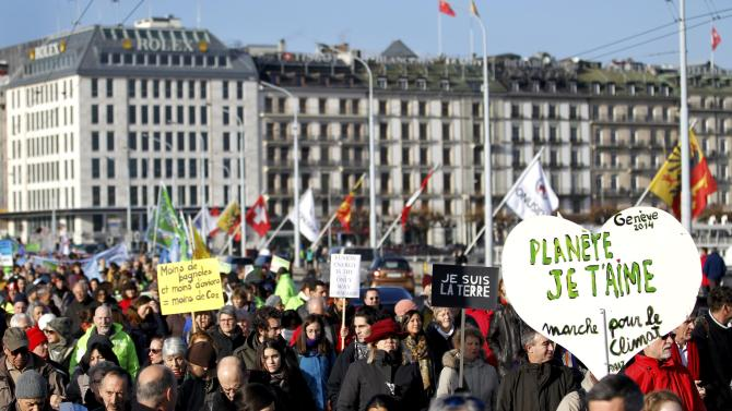 Protesters rally ahead of COP21 summit in Geneva
