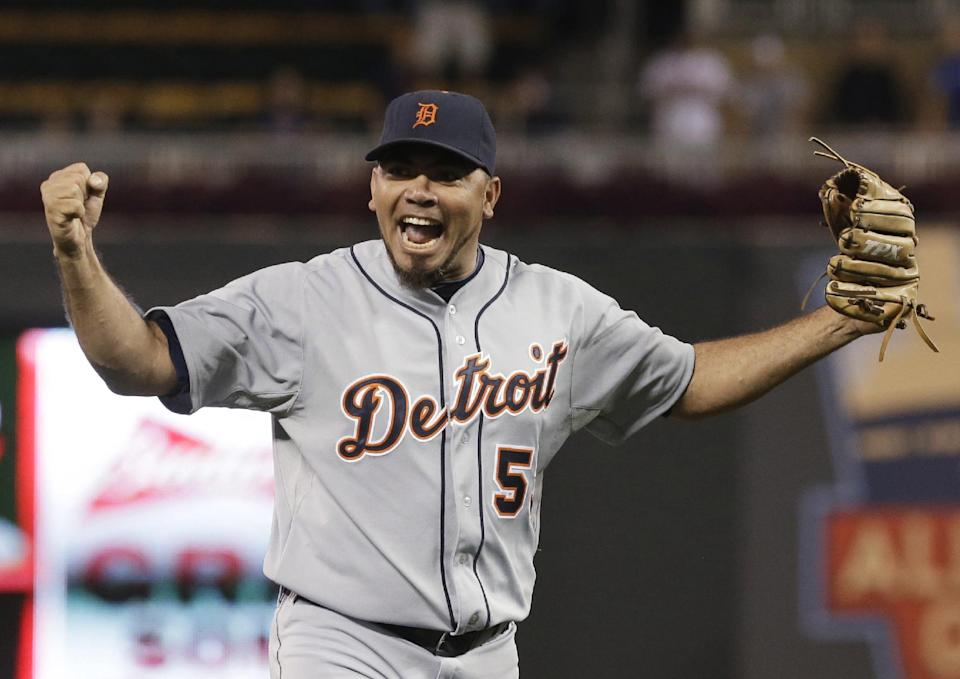 Detroit Tigers pitcher Joaquin Benoit celebrates after striking out Minnesota Twins' Josh Willingham to end the baseball game, Wednesday, Sept. 25, 2013, in Minneapolis, where the Tigers won 1-0, clinching the AL Central title. (AP Photo/Jim Mone)