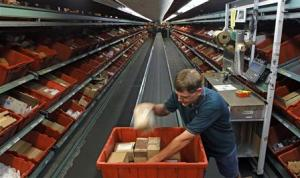 Worker David Lloyd handles an order in the active items…