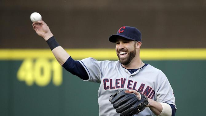 Cleveland Indians' Jason Kipnis smiles as he tosses a ball before a baseball game against the Seattle Mariners Thursday, May 28, 2015, in Seattle. (AP Photo/Elaine Thompson)