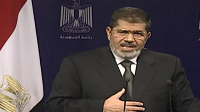 This image made from video broadcast on Egyptian State Television shows President Mohammed Morsi addressing the nation in a televised speech on Tuesday, July 2, 2013. With the clock ticking, Egypt's besieged president said Tuesday that he will not step down as state media reported that the powerful military plans to overturn his Islamist-dominated government if the elected leader doesn't meet the demands of the millions of protesters calling for his ouster.(AP Photo/Egyptian State Television)