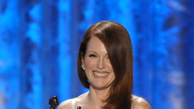 """Julianne Moore accepts the award for outstanding female actor in a TV movie or miniseries for """"Game Change"""" at the 19th Annual Screen Actors Guild Awards at the Shrine Auditorium in Los Angeles on Sunday, Jan. 27, 2013. (Photo by John Shearer/Invision/AP)"""