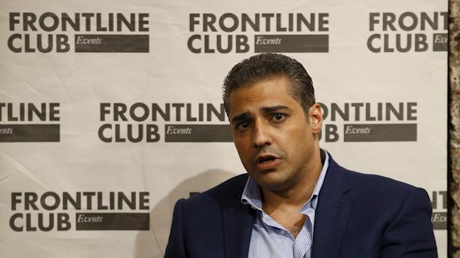 Canadian journalist Mohamed Fahmy, who was recently freed from jail in Egypt, talks to an audience at an event at the Frontline Club in London, Britain.