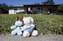 A pair of toy animals are seen as part of memorial outside the home, Monday, May 20, 2013, where Elvira Campos, 10, was shot and killed in North Highlands, Calif. Campos had been watching television with her parents Saturday night, when at least two gunmen walked up to the door of the home and began shooting. About a dozen shots were fired, killing Campos&#039; and wounding her father and mother. (AP Photo/Rich Pedroncelli)