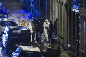 Belgian police block a road in central city of Verviers where Belgian counter-terrorist police raided an apartment