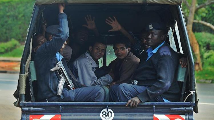 Somali and Ethiopian nationals arrested as part of a crackdown on terrorism by Kenyan national security officers sit in a police truck on April 17, 2014, in Nairobi