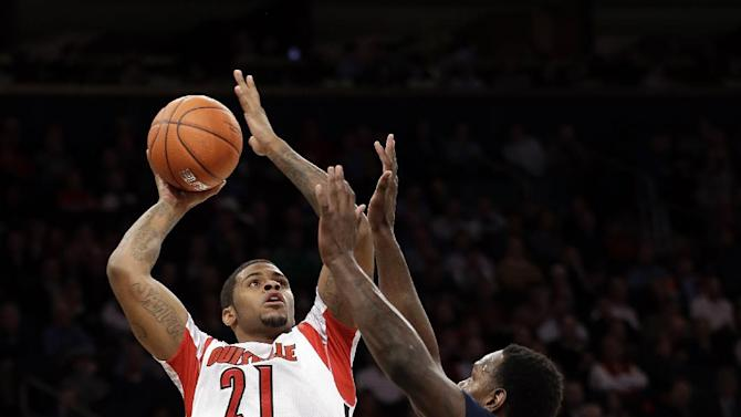 Louisville's Chane Behanan (21) shoots over Villanova's JayVaughn Pinkston (22) during the first half of an NCAA college basketball game at the Big East Conference tournament, Thursday, March 14, 2013, in New York. (AP Photo/Frank Franklin II)