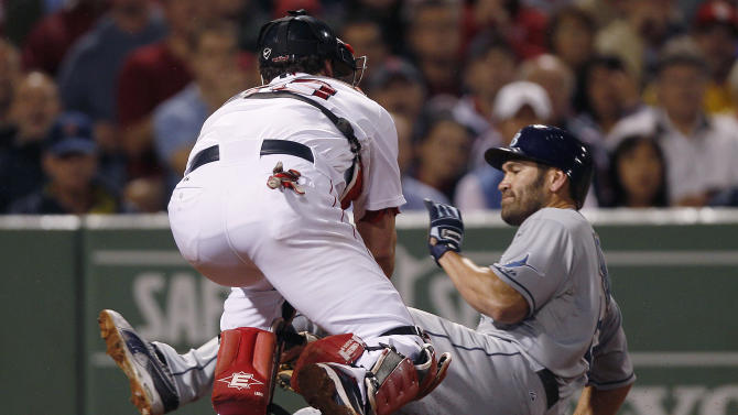 Boston Red Sox catcher Jason Varitek, left, tags out Tampa Bay Rays Johnny Damon, who tried to score on a ball hit by John Jaso during the fourth inning of a baseball game at Fenway Park in Boston, Thursday Sept. 15, 2011. (AP Photo/Charles Krupa)