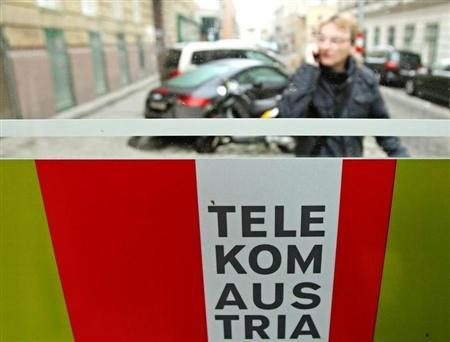 A man talks on his mobile phone outside a Telekom Austria phone booth in Vienna