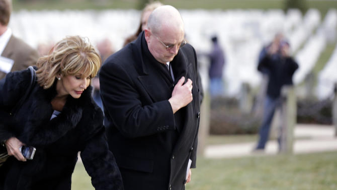 Diana Rambo, and her husband Lorin Rambo, from Fresno, Calif., pause at a casket of unidentified remains after services to honor two sailors from the Civil War ship, the USS Monitor, at Arlington National Cemetery, Friday, March 8, 2013 in Arlington, Va. Mrs. Rambo is related to USS Monitor crew member Jacob Nicklis. A century and a half after the Civil War ship the USS Monitor sank, two unknown crewmen found in the ironclad's turret were buried at Arlington National Cemetery. Friday's burial may be the last time Civil War soldiers are buried at the cemetery. (AP Photo/Alex Brandon)