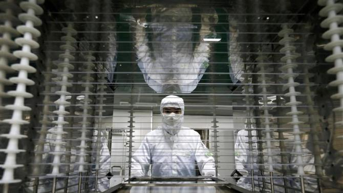 File photo of an employee working inside an electronic products factory in Huzhou