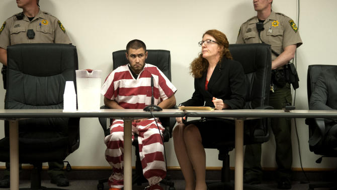Court appointed public defender Maily Walsh sits next to Jonathan Renfro, who is suspected of shooting Coeur d'Alene police Sgt. Greg Moore, as he makes his first appearance in a courtroom at the Kootenai County Jail in Coeur d'Alene, Idaho on Tuesday, May 5, 2015. The northern Idaho police officer died of his injuries Tuesday evening, police said. (Kathy Plonka/The Spokesman-Review via AP) COEUR D'ALENE PRESS OUT