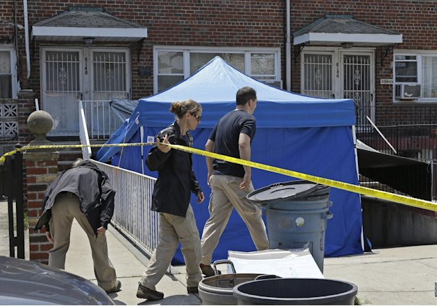 FBI agents duck under crime scene tape in front a New York city house once occupied by a famous gangster, Tuesday, June 18, 2013, in New York.  The work started Monday at the home of James Burke, a Lu