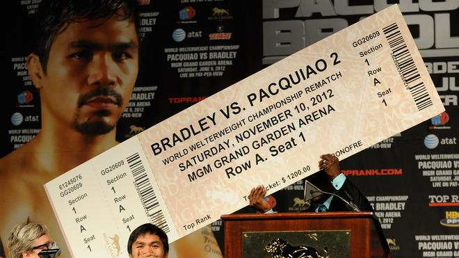 Boxer  Timothy Bradley (R) Holds Up An Oversize  Fake Ticket Predicting A Rematch With Trainer Freddie Roach (L) And  Getty Images