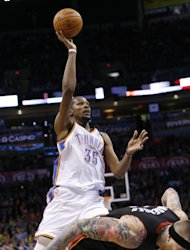Oklahoma City Thunder's Kevin Durant (35) shoots over Miami Heat forward Chris Andersen (11) following a foul by Andersen during the third quarter of an NBA basketball game in Oklahoma City, Thursday, Feb. 20, 2014. Miami won 103-81. (AP Photo/Sue Ogrocki)