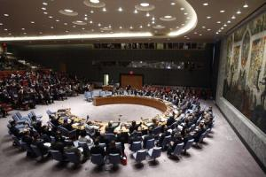 Members of the Security Council vote during meeting…