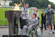 Paralympian athlete Angela Hendra lights the cauldron during a London Paralympic Games ceremony in Belfast on Saturday. Sport for disabled people was pioneered by Ludwig Guttmann at England's Stoke Mandeville hospital