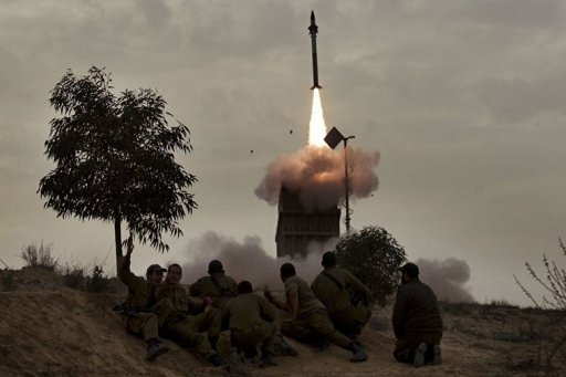 Israeli soldiers watch as a missile is launched from the Iron Dome defence system in the southern Israeli city of Beer Sheva in March 2012. Israel on Sunday began testing an SMS system for warning the public of an imminent missile attack as chatter over a possible strike on Iran dominated the Israeli press headlines.