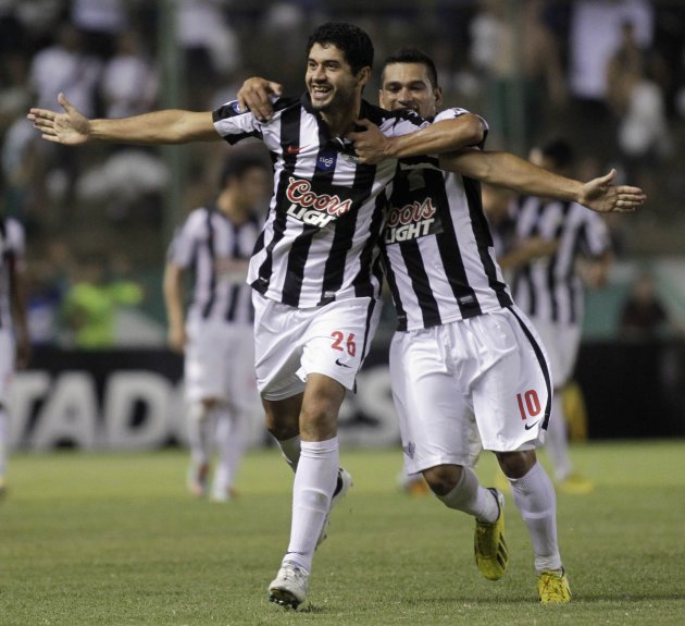 Benitez and teammate Samudio of Paraguay's Libertad celebrates their team's goal against Brazil's Palmeiras during a Libertadores Cup soccer match in Asuncion
