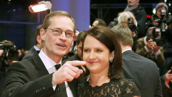 Berlin Mayor Mueller and his wife Claudia arrive on red carpet for screening at opening gala of 66th Berlinale International Film Festival in Berlin