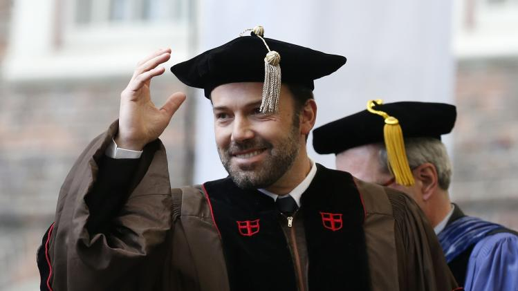 Ben Affleck gestures before receiving an honorary degree at Brown University's 245th commencement in Providence, R.I., Sunday, May 26, 2013. (AP Photo/Michael Dwyer)