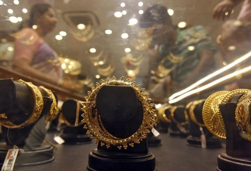 Gold prices notch first weekly gain in four as Asian demand rises